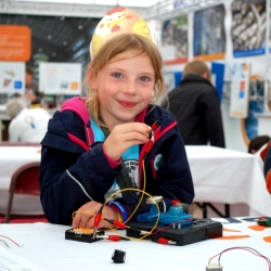 Little smiling girl with electrical leads