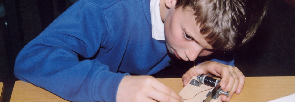 Young boy working on a morse code buzzer