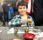 Boy at table with Meccano kit