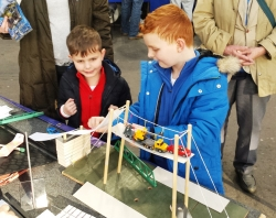 2 boys with model bridge